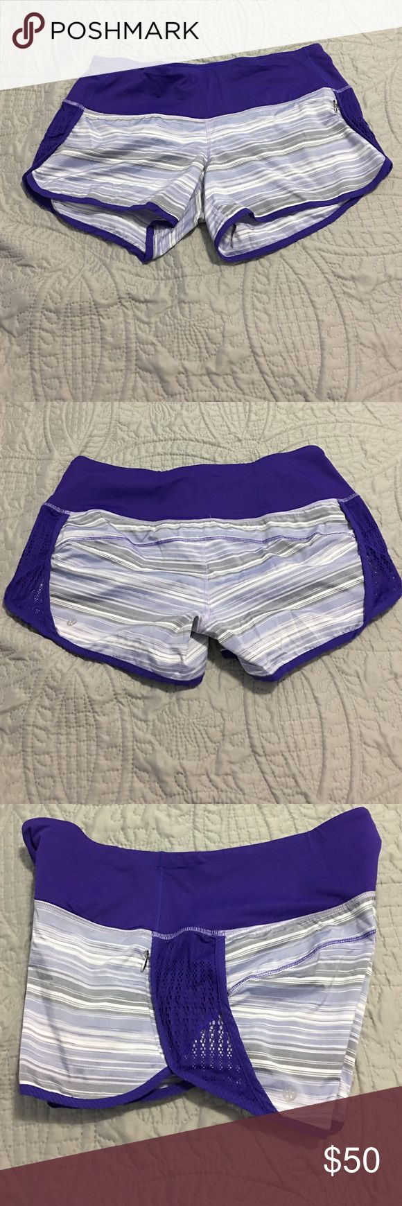 Lululemon Sun Sprinter Short Excellent condition! Worn only a couple of times. Purple with multi colored stripes. Purple lace detail down sides. Zipper pocket on side and key holder at waistband. No lining. Discontinued Lulu style. lululemon athletica Shorts