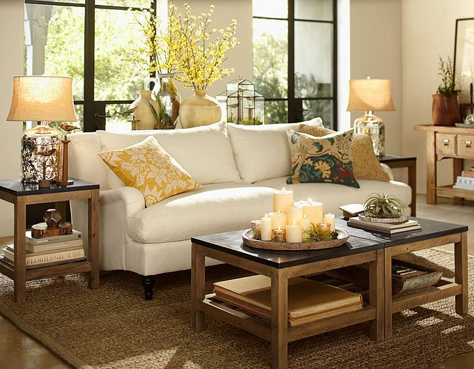 Like the candle grouping on tray for lr coffee table for Living room table decorating ideas