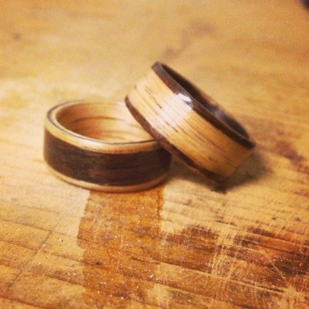 Lovely His and hers opposites Oak and Rosewood inlayed wedding band set