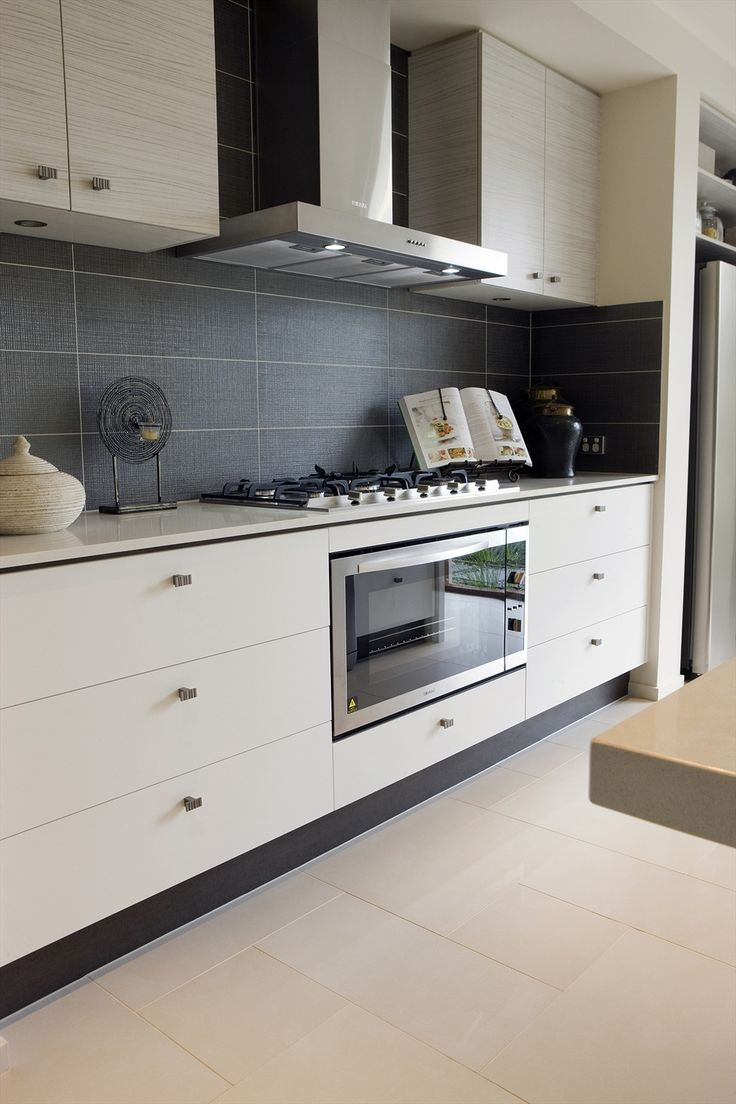 Whether your kitchen is rustic and cozy or modern and sleek, we've got backsplash ideas in mirror, marble, tile, and more. Find and save ideas about Kitchen splashback tiles in this article. | See more ideas about Splashback tiles, Kitchen splashback ideas and Kitchen splashback inspiration. #KitchenIdeas #kitchendesign #kitchendecor #kitchensplashback