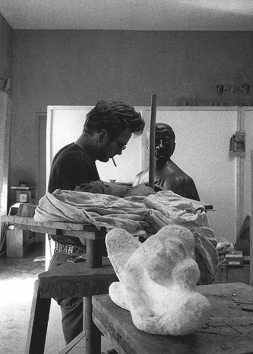 James Dean sculpting, photographed by Sanford Roth, 1955.