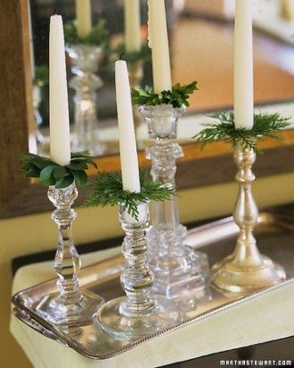 Bobeches, those little glass collars meant to catch dripping candle wax, get an informal holiday makeover with evergreen leaves and wire.