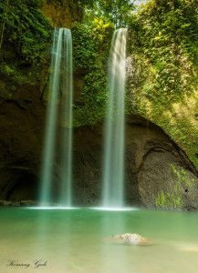 Tibumana Waterfall is twin waterfalls are located on the island of Bali, exactly in Weak Wake Banjar Kawan Village Apuan, District Susut, Bangli regency, about 40 km or 1.5 hours from the city of Denpasar. To get here, visitors must pass through dozens of steps. While the steep little road which is made from a wooden staircase. It does require an extra struggle, but the fatigue that will pay off when a visitor arrives at the site.
