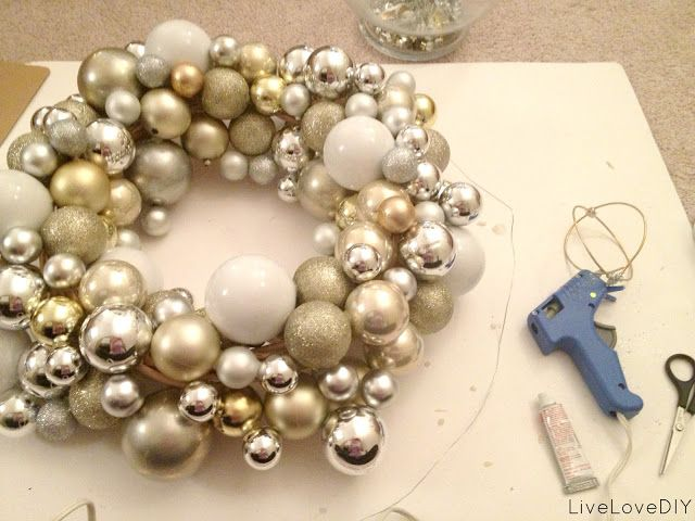How to make your own Christmas ornament wreath for less than $10! LOVE this!