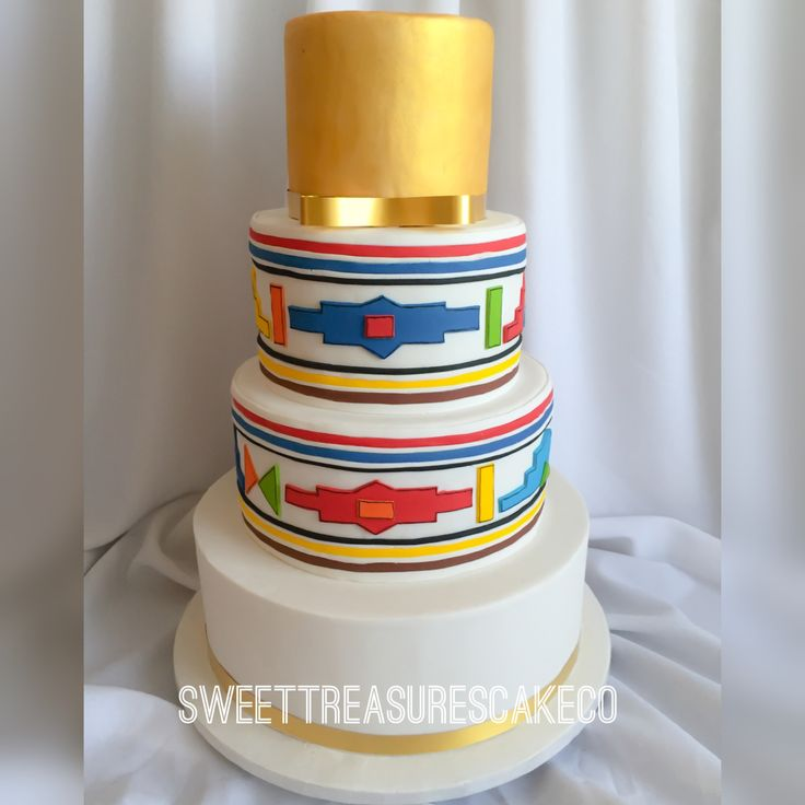 You cannot imagine how excited I was to make this fabulous wedding cake... 😍. Handcut the Ndebele shapes which I used to decorate the middle tiers and dusted the top tier with gold dust 😍😍😍.  #johannesburg #joburg #cake #weddingcake #weddings #weddingthings #traditionalwedding #whitewedding #ndebele #heritage #culture #sweettreasures #sweettreasurescakeco #customcakes #bestcakesintown #westaywinning #weddingslay