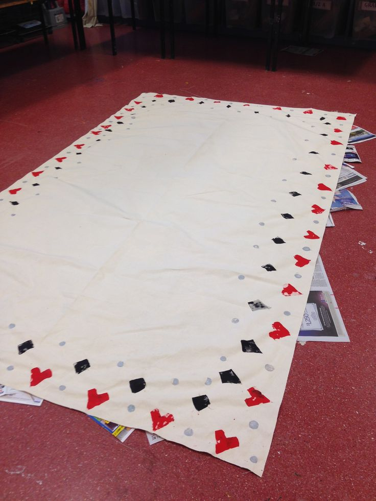 Alice in Wonderland tablecloth fabric printing. Cut foam shapes and corks.