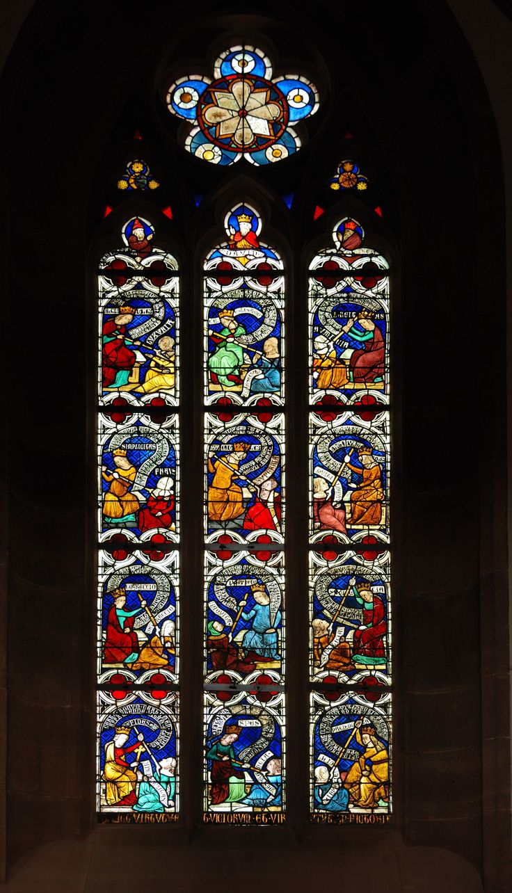 Virtues fighting vices, stained glass window (14th century) in the Niederhaslach Church