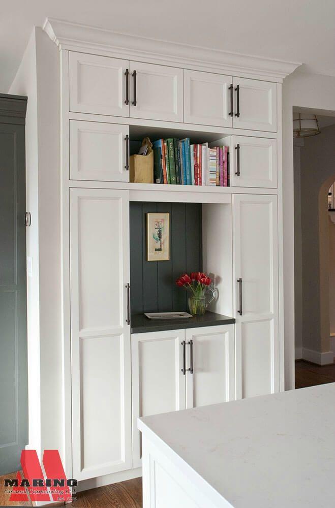 kitchen storage with a dark accent wall
