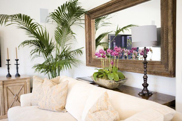 Wonderful hand carved mirror over couch with tropical elements and console table.  Finally something to think about for my living room re-do