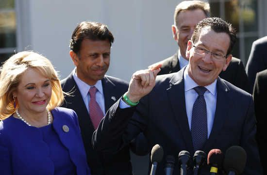 Governors Mary Fallin (L) (R-OK) and Bobby Jindal (R-LA) listen as Governor Dannel Malloy (R) (D-CT) speaks to reporters after a National Governors Association event hosted by U.S. President Barack Obama at the White House in Washington February 24, 2014.