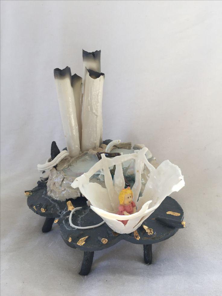 Stoneware, porcelain, glass, iron, gold.