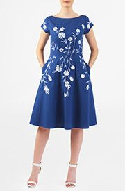 Fresh florals amp up the sweet charm of our polydupioni dress, cut in a flattering fit-and-flare silhouette with a gracefully arched high-low hem.