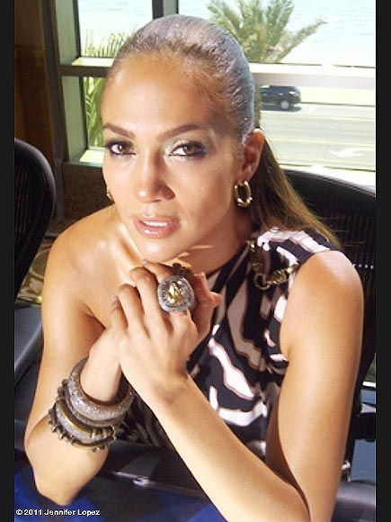 Celebrity Jewelry: Jennifer Lopez, layered bracelets, chunky ring, simple earrings