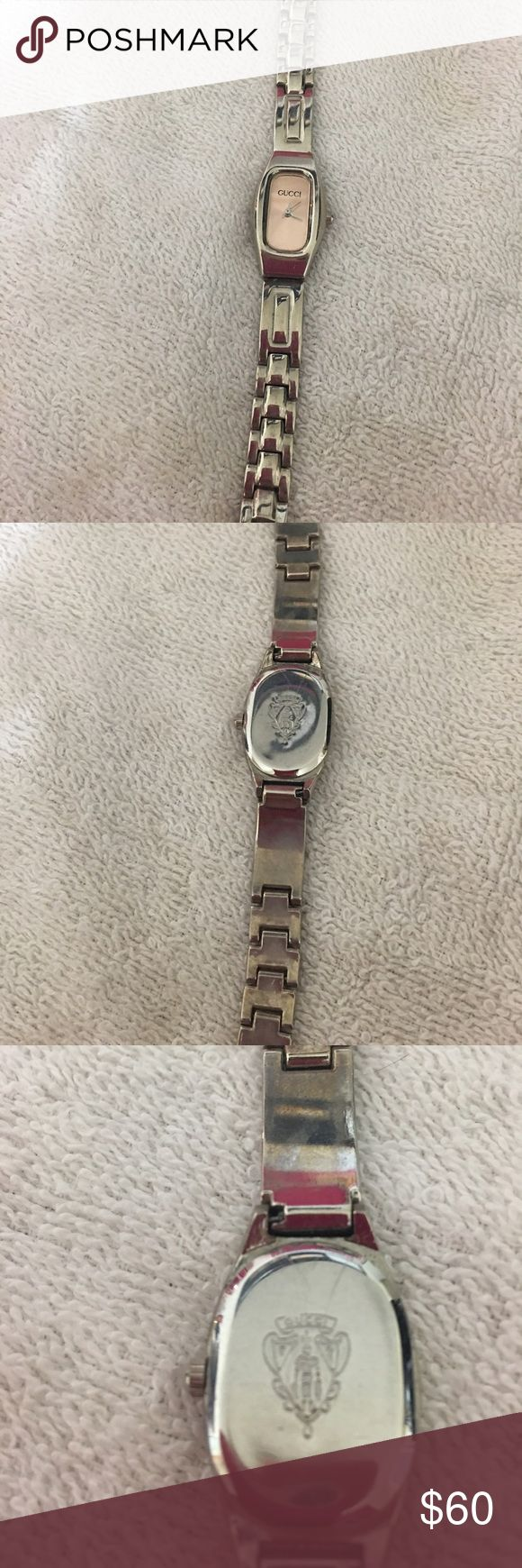 Vintage Gucci Watch Pink Face and Aluminum body Vintage Gucci watch with crest on back. Watch is pretty worn and decently old. Authenticity can't be verified due to it being an older piece price reflects that as well. Also needs new battery. Gucci Accessories Watches