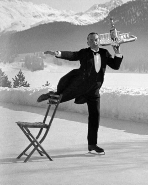 This is the true spirit of the holidays  legrandcirque:    Waiter Rene Brequet with a tray of cocktails as he skates around a rink serving sidelined patrons at the Grand Hotel. Photograph by Alfred Eisenstaedt. St. Moritz, Switzerland, 1932.