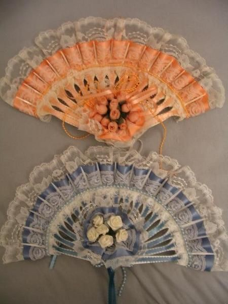 Plastic Fork Fans. I have made these and they are fun and beautiful.