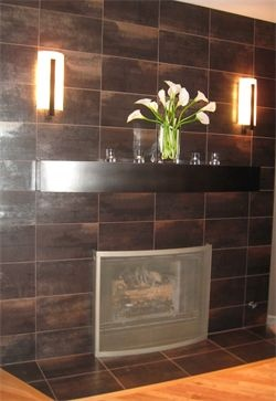 Metallic tile fireplace with custom curved metal mantel