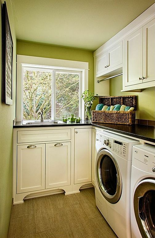 PERFECT layout for a long, narrow laundry room with window on the far wall. Excellent use of dead corner, will have the contractor copy this layout just add a shelf above the sink with hanging bar there. laundry room with sink
