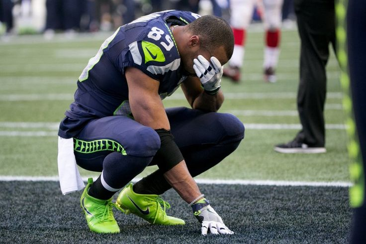 Prayer for Tyler - Seattle Seahawks wide receiver Doug Baldwin (89) reacts after Seattle Seahawks wide receiver Tyler Lockett (16) was injured near the endzone in the second quarter.