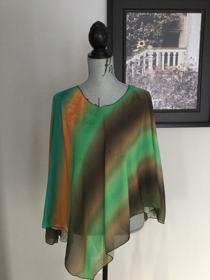 Super cute poncho type wrap that has side slits so your arms are free.  Can also be worn as a scarf.  Chiffon in soft sorbet colours .  Perfect as a swimsuit coverup or anytime coveruup