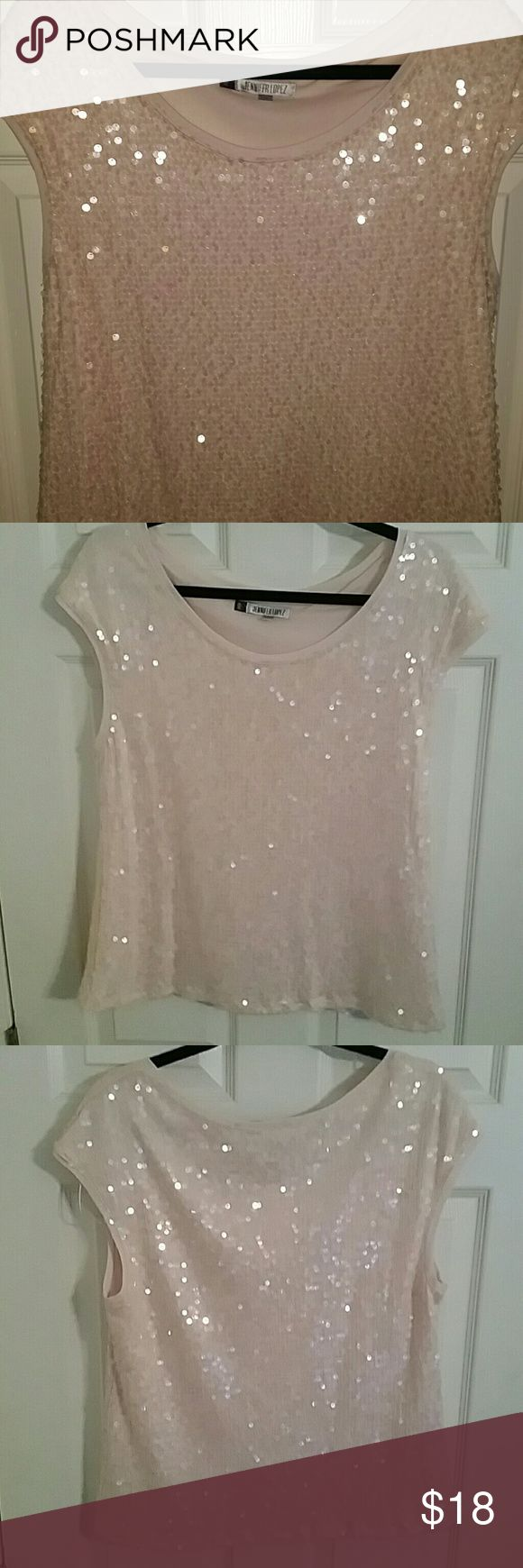 Super Sparkle champagne blush sleeveless shirt This is a fully sequined shirt, it does not only have sparkle in the front,  it sparkles in the back as well ! It's a full 360 celebration of shininess! This is casual enough to wear to work under  a coat  or Blazer yet definitely dressy enough to put on for that special party or holiday event. This shirt is fully lined so you won't get the itches from all of the thread work holding on hundreds of awesome clear iridescent sequins on a champagne…