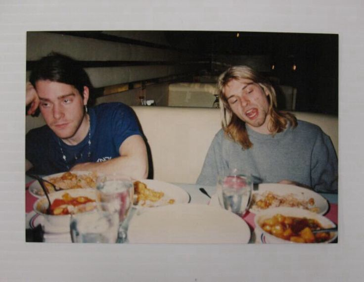 Photo of Kurt Cobain and Chad Channing at a meal during their 1990 US tour.