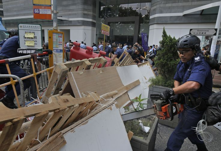 Hong Kong police take chainsaws to democracy protesters' barricades  Hundreds of police used chainsaws and other power tools early Tuesday to remove barricades set up by Hong Kong protesters, continuing the government's slow squeeze on the democracy demonstrations that that have blocked some streets for more than two weeks.  http://www.latimes.com/world/asia/la-fg-hong-kong-police-chainsaws-protest-barricades-20141013-story.html
