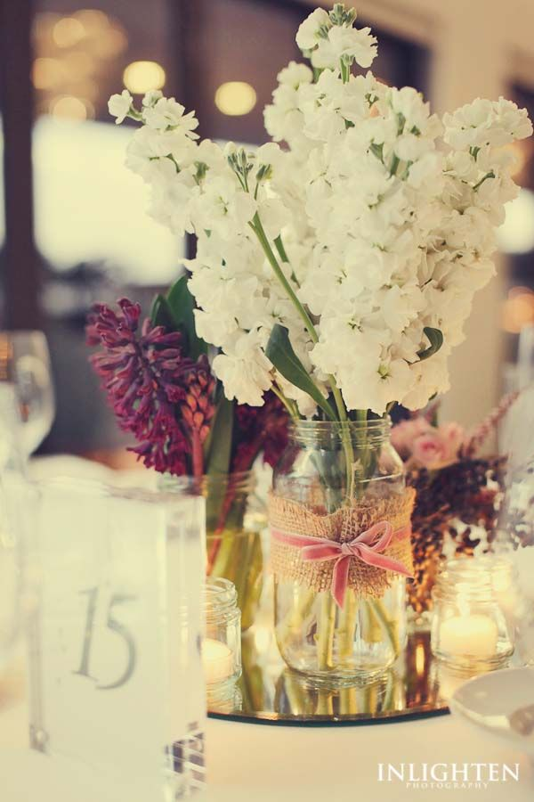 Sergeants Mess -  Simple, elegant, wedding reception floral bouquet centerpiece accompanied by romantic table candle light.