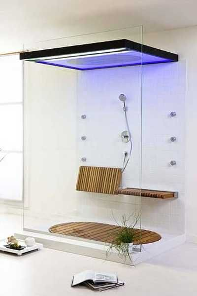 Blue lit ceiling, wall jets & wood benches= Great Glass Shower Design Idea & Inspirations