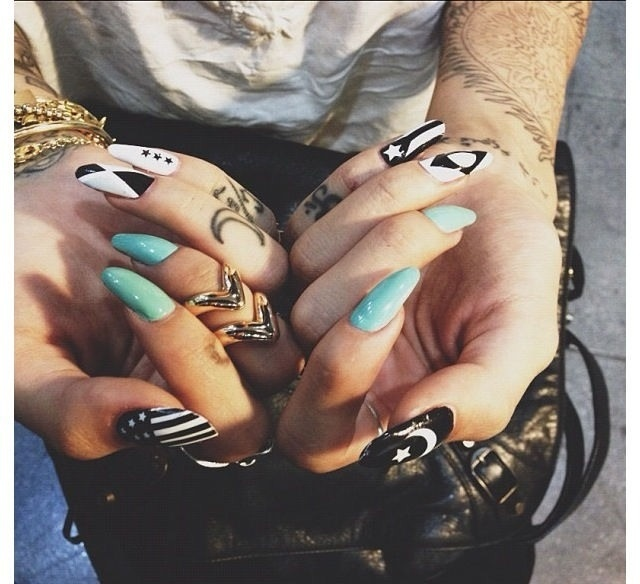 Long nails with black, white, & mint color.