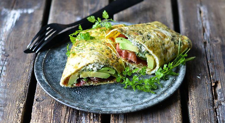 Healthy lunch or dinner: Egg Wrap with Avocado, Herbs and Feta Cheese spread