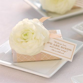 WEDDING COLOR SCHEME: WHITE AND PEAC    In Favor    At a wedding at Lowndes Grove Plantation, in South Carolina's Lowcountry, the parting gifts are adorned with paper printed with a customized pattern used throughout the decor, a ranunculus blossom and a card bearing a favorite quote. Favor-box design by The