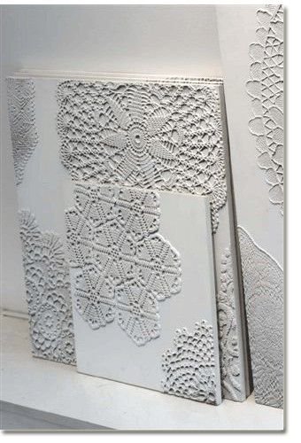 Lace doilies on canvas, painted white