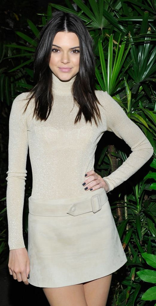 Kendall Jenner wore a glittering neutral turtleneck and belted mini skirt at her #MyCalvins party.