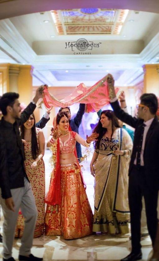 Apparently this is a very fun wedding! Photo by HocusFocus Captures, Mumbai #weddingnet #wedding #india #indian #indianwedding #weddingdresses #mehendi #ceremony #realwedding #lehenga #lehengacholi #choli #lehengawedding #lehengasaree #saree #bridalsaree #weddingsaree #indianrituals #indianweddingrituals #ceremonies #weddingceremonies