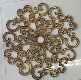 """Wonderful swirly and curvy metal grille brightened with hand applied gold leaf. It's a wall decoration or a fabulous ceiling medallion above your chandelier. 31"""" diameter. SOLD"""