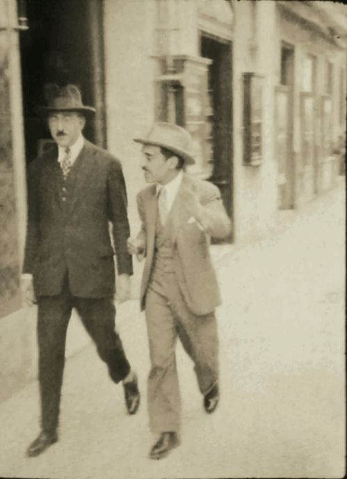 Fernando Pessoa strolling down Chiado Square (Lisbon), with his friend, journalist Augusto Ferreira Gomes  c. 1925