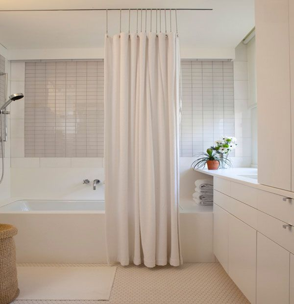 Hanging shower curtains with sleek rods and pins. floor to ceiling shower curtain.