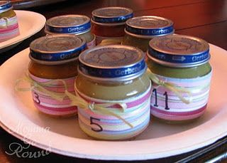 Guess the baby food! Awesome baby shower game! we had camo theme and put camo duct tape around them instead :)