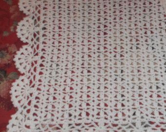 Is there a new baby coming? Is there a Baptism / Christening in their future? This hand-crocheted white baby afghan measures approximately 45 x 33 inches (approximately 114.3 x 83.3 cm).  Machine washable.