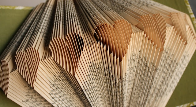 Great find today - this blog offers oodles of instructions for book folding