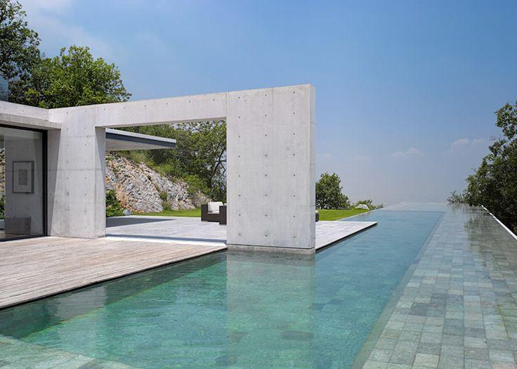 Tadao Ando's Casa Monterrey nestles against a hillside in Monterrey + infinity pool!