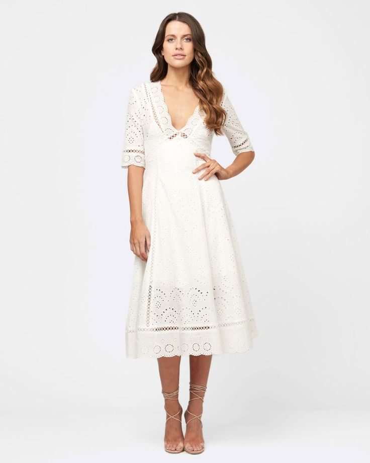 White lace midi length dress from MVN.