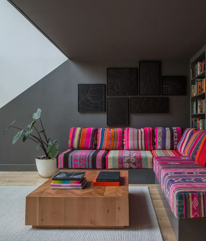 giant sofa is upholstered in 18 Peruvian blankets that