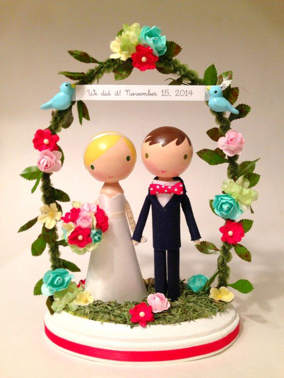 Materials: wood, paint, cotton, glue, love...this listing is for one custom handmade wedding cake topper with floral arch.  *please read the ordering instructions before purchase. thank you