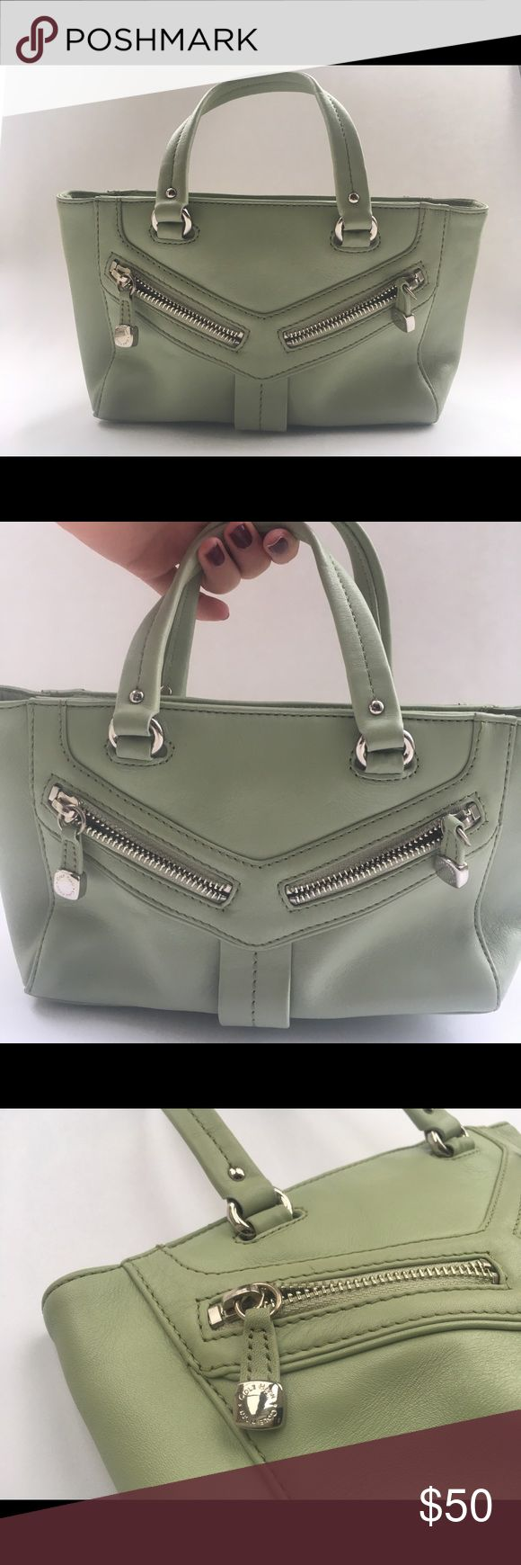 """Cole Haan Handbag Mint Green SOLD OUT! Absolutely gorgeous Cole Haan Alexa Bag! Beautiful mint green color-perfect for spring! Excellent condition. Super soft leather. Silver zippered detailing. Dimensions: Approx. 10.5"""" L x 5.5"""" H x 4.75"""" D Extremely minor flaws, and the interior is in perfect shape (see pictures)! We will consider offers!  Please note: All sales are final, no returns or exchanges. Cole Haan Bags Mini Bags"""