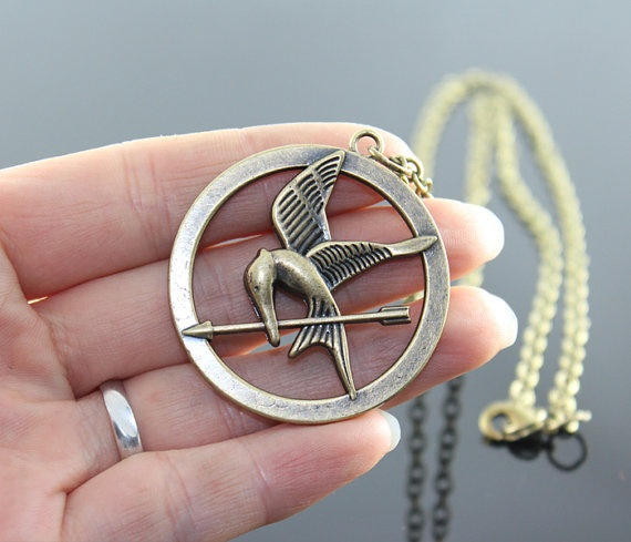 The Hunger Games  pendant Inspired Mockingjay by BeautyandLuck, $4.99....I WANT IT!!!!!!!!!