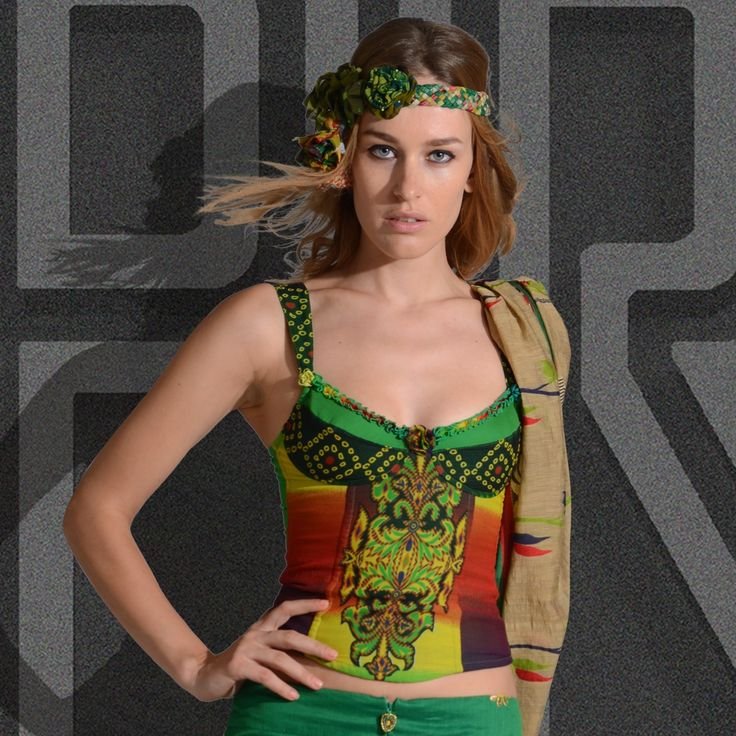 The Airlia Bustier is made georgette hand blocked printed fabric with straps, accessory flowers, and heart beaded zipper. This bustier is available in 4 color themes.