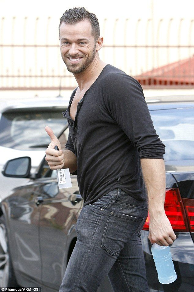 Thumbs up: Lea's dance partner Artem Chigvintsev threw up a thumbs up as he was seen exiting the studio possibly expressing a successful practice