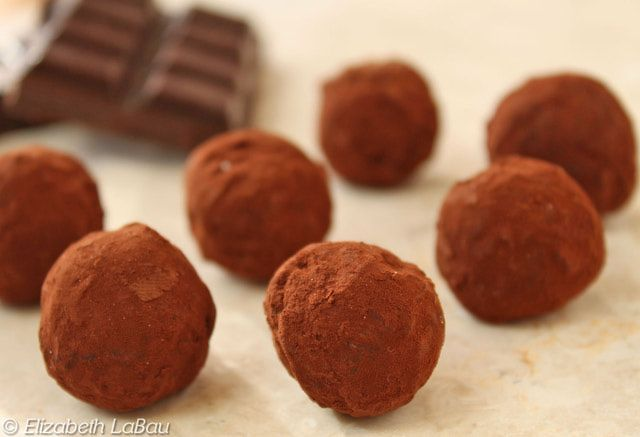 Dark chocolate and cream come together to form divine, melt-in-your-mouth dark chocolate truffles.